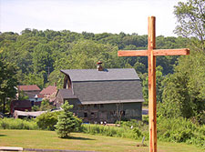 building with large wooden cross in front